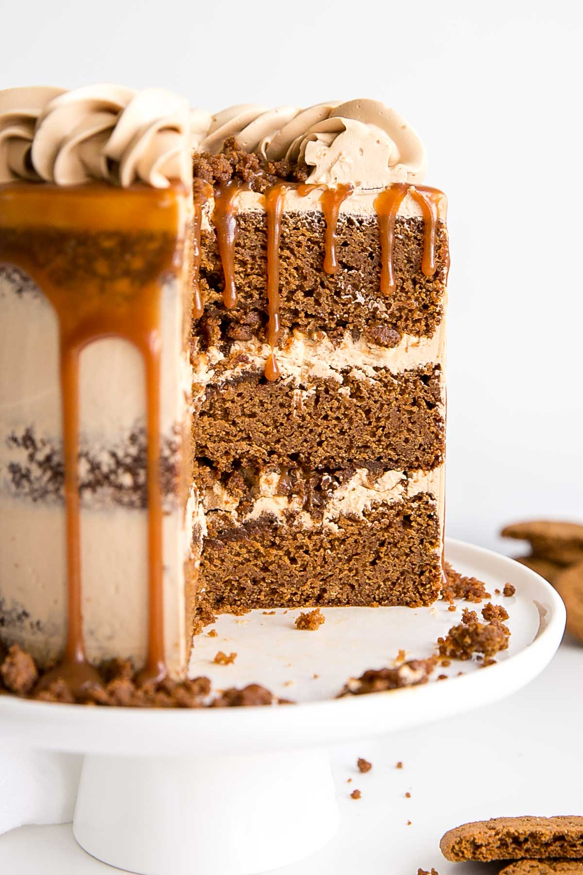 Cross-section of a gingerbread cake with caramel Swiss meringue buttercream.