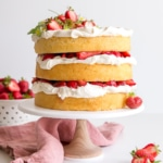 This Strawberry Shortcake Cake gives a new twist to an old classic. Vanilla cake layers, fresh strawberries, and mascarpone whipped cream!   livforcake.com