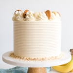 This Banana Pudding Cake combines all of the elements of the classic southern dessert. Vanilla cake, banana pudding, and vanilla wafers with vanilla buttercream and fresh whipped cream. | livforcake.com