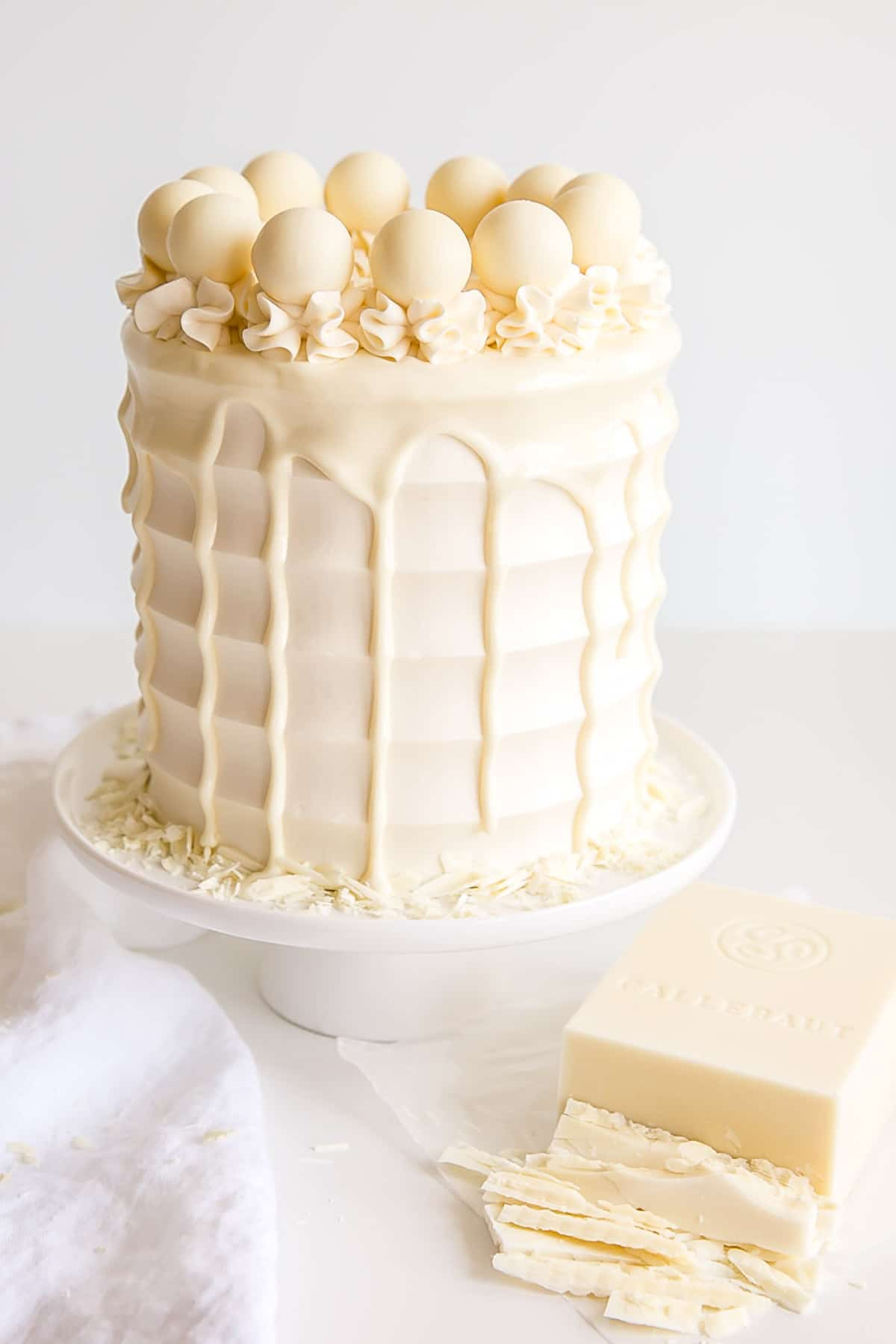 White Chocolate Cake with a chopped up bar of white chocolate on the side.