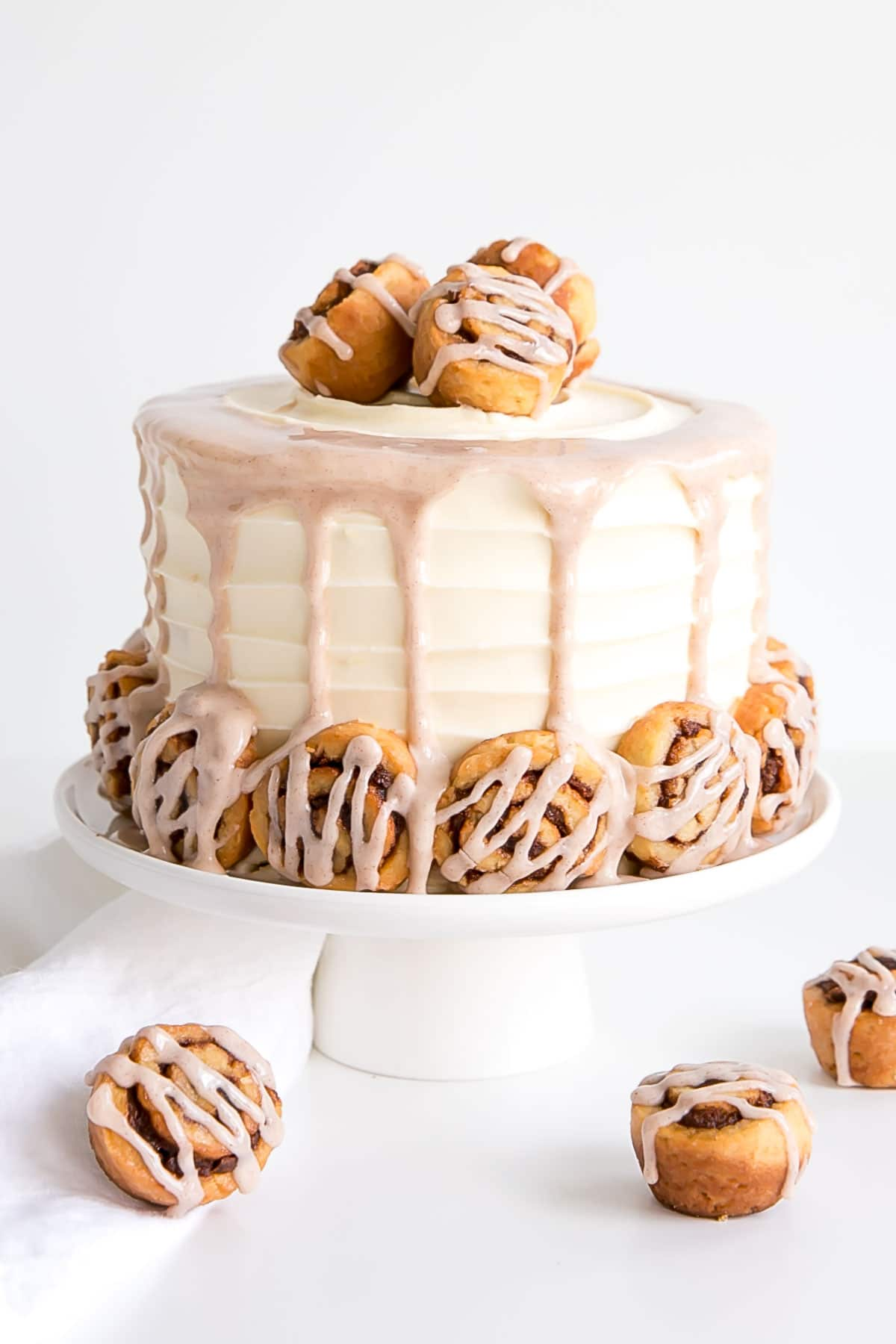 Cinnamon Roll Cake with mini cinnamon rolls and a cinnamon glaze.