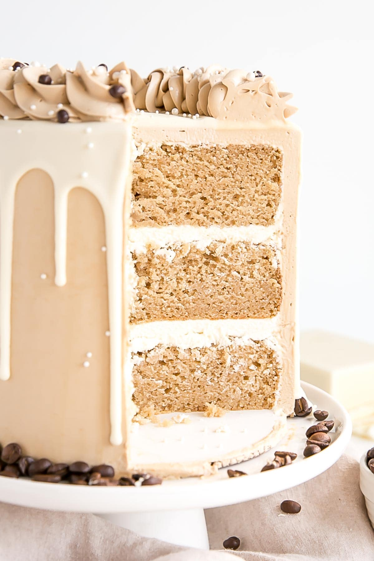 Cross section of the cake showing layers and white chocolate ganache filling.
