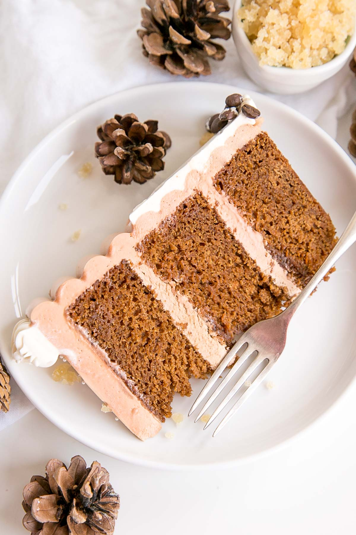 Slice of gingerbread latte cake on a plate.