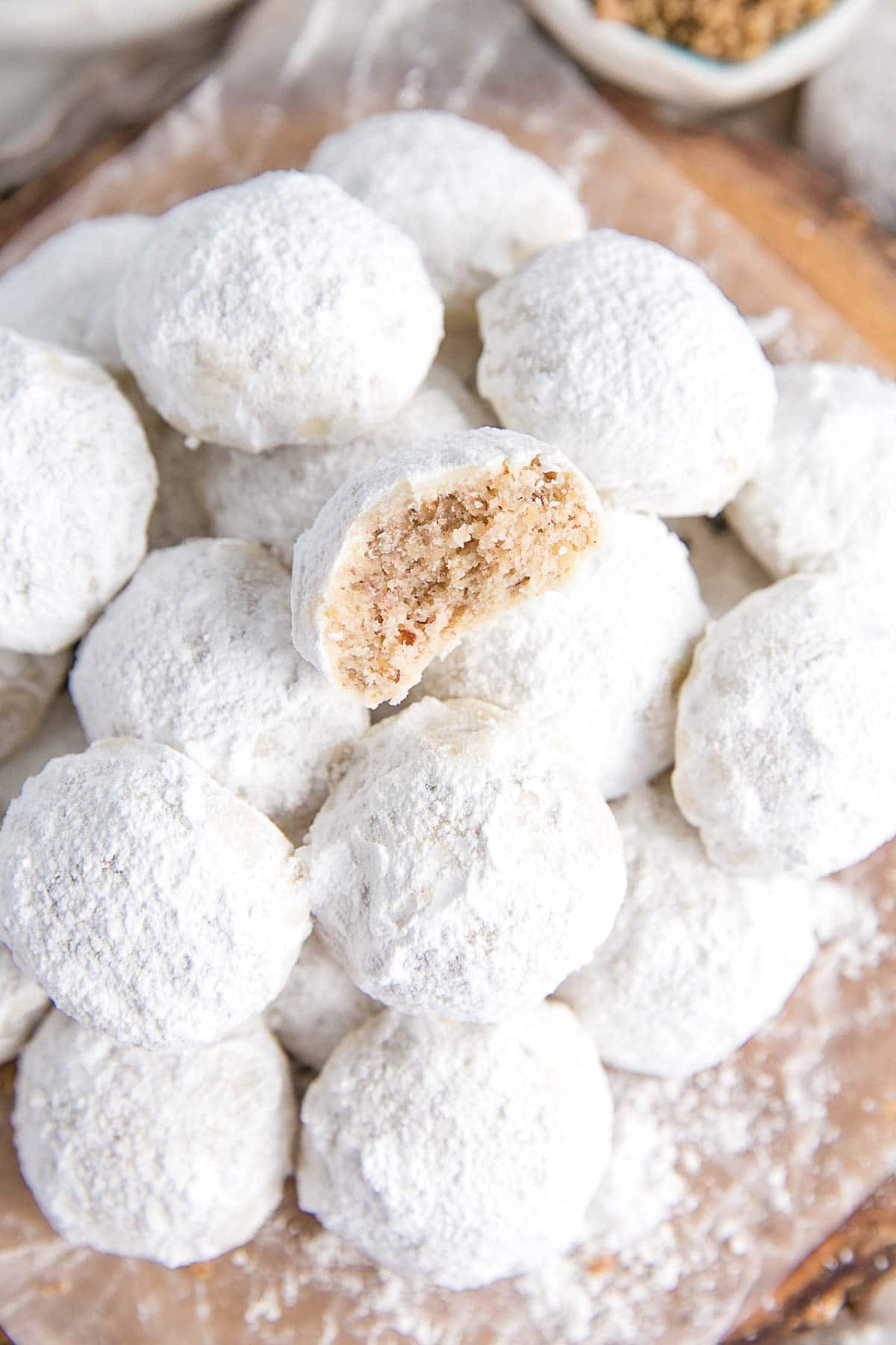 Pecan butter cookies dusted with powdered sugar.