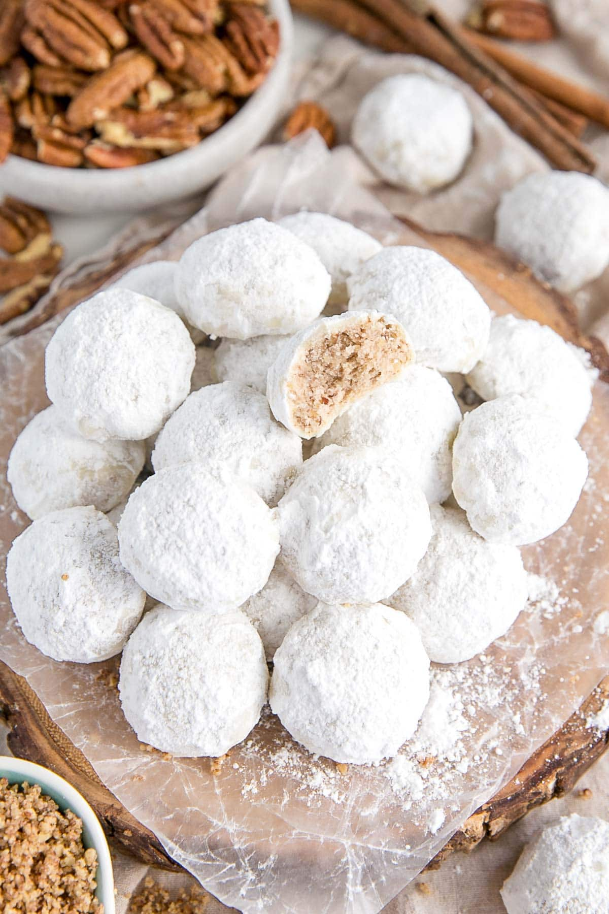 Stack of snowball cookies on a plate.