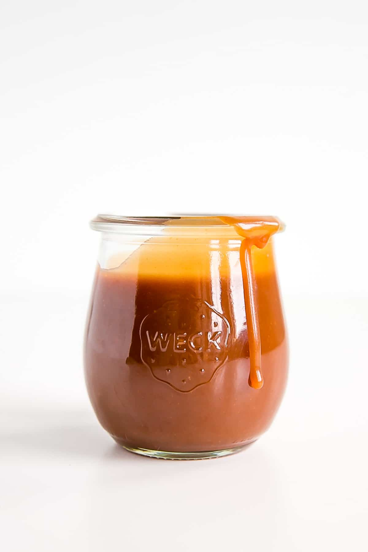 Homemade caramel sauce in a jar