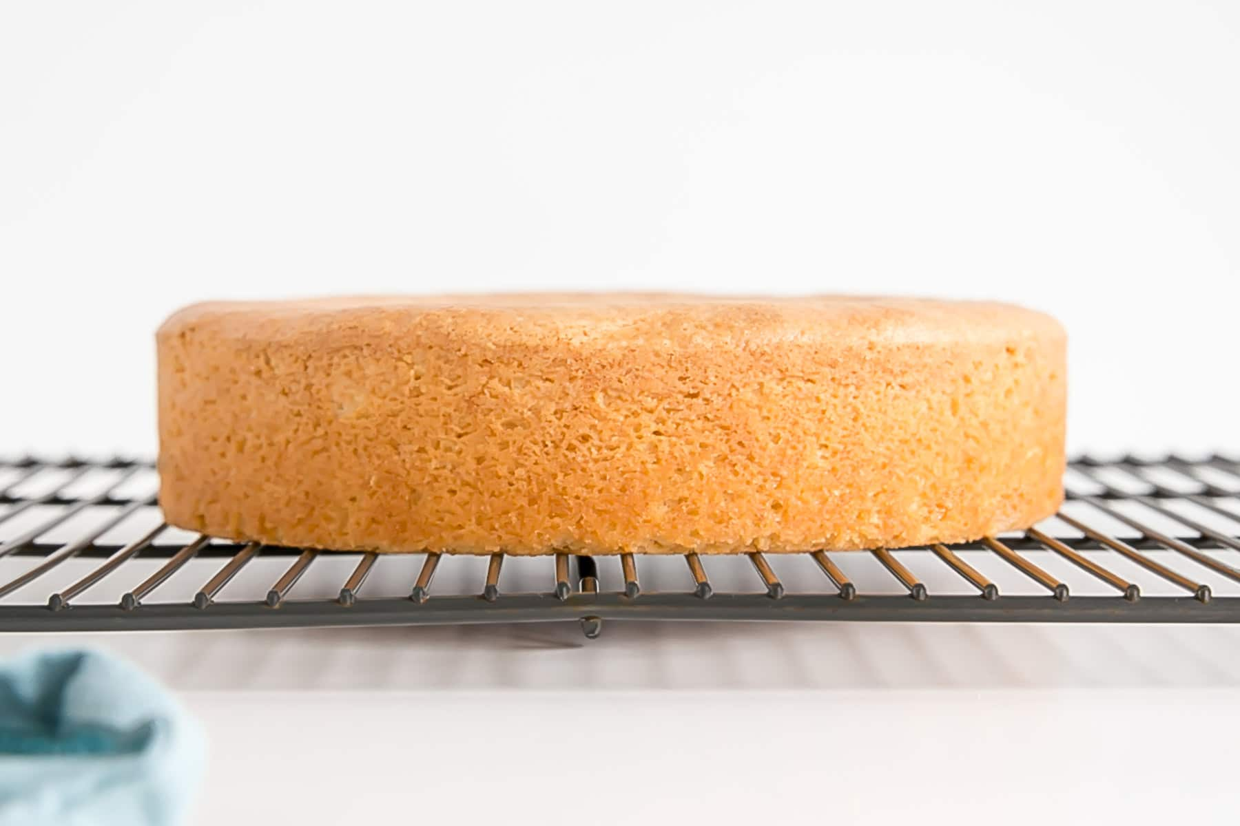 Perfectly flat cake on a cooling rack.