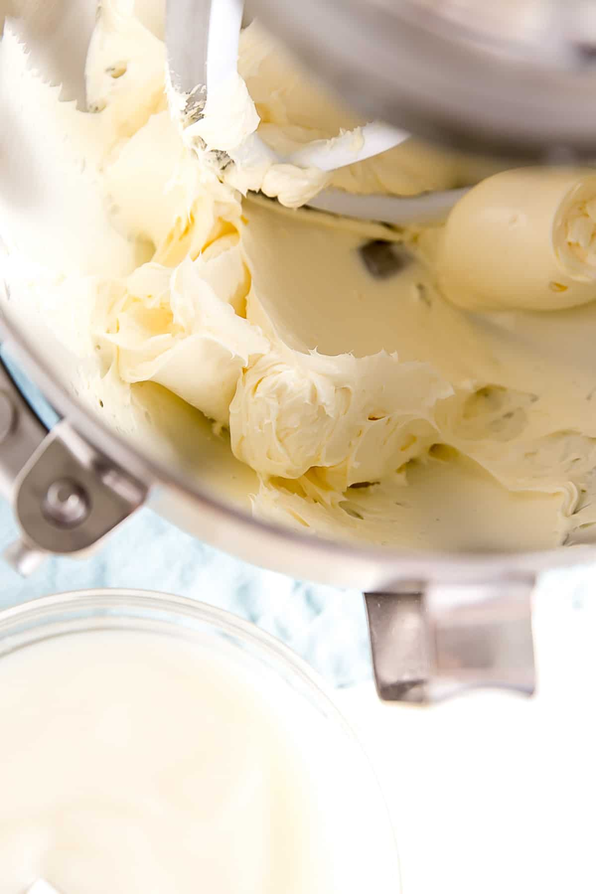Creamed butter in the bowl of a stand mixer.