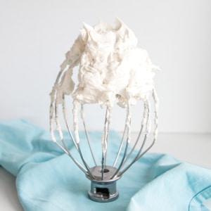 white frosting on a whisk.