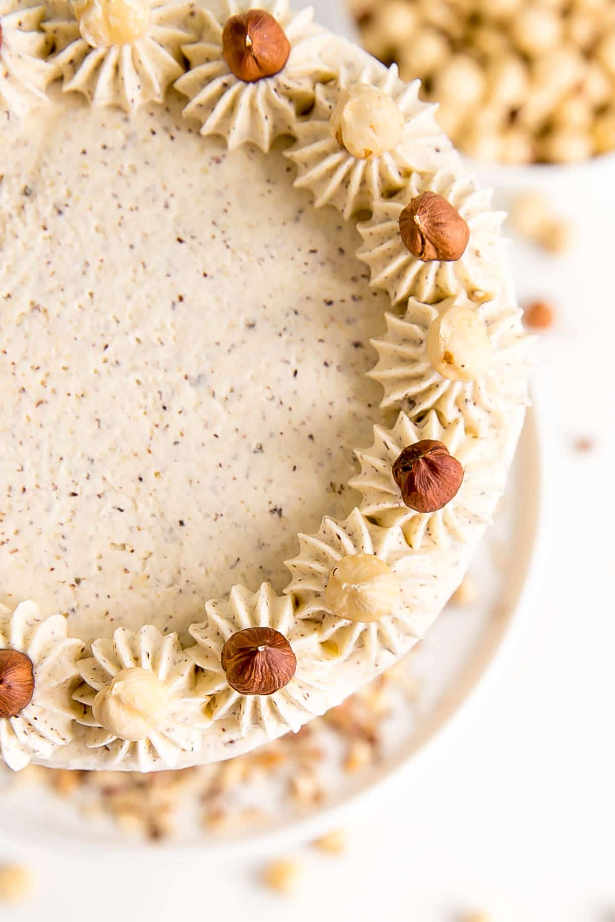 Overhead shot of the cake showing dollops and hazelnuts.