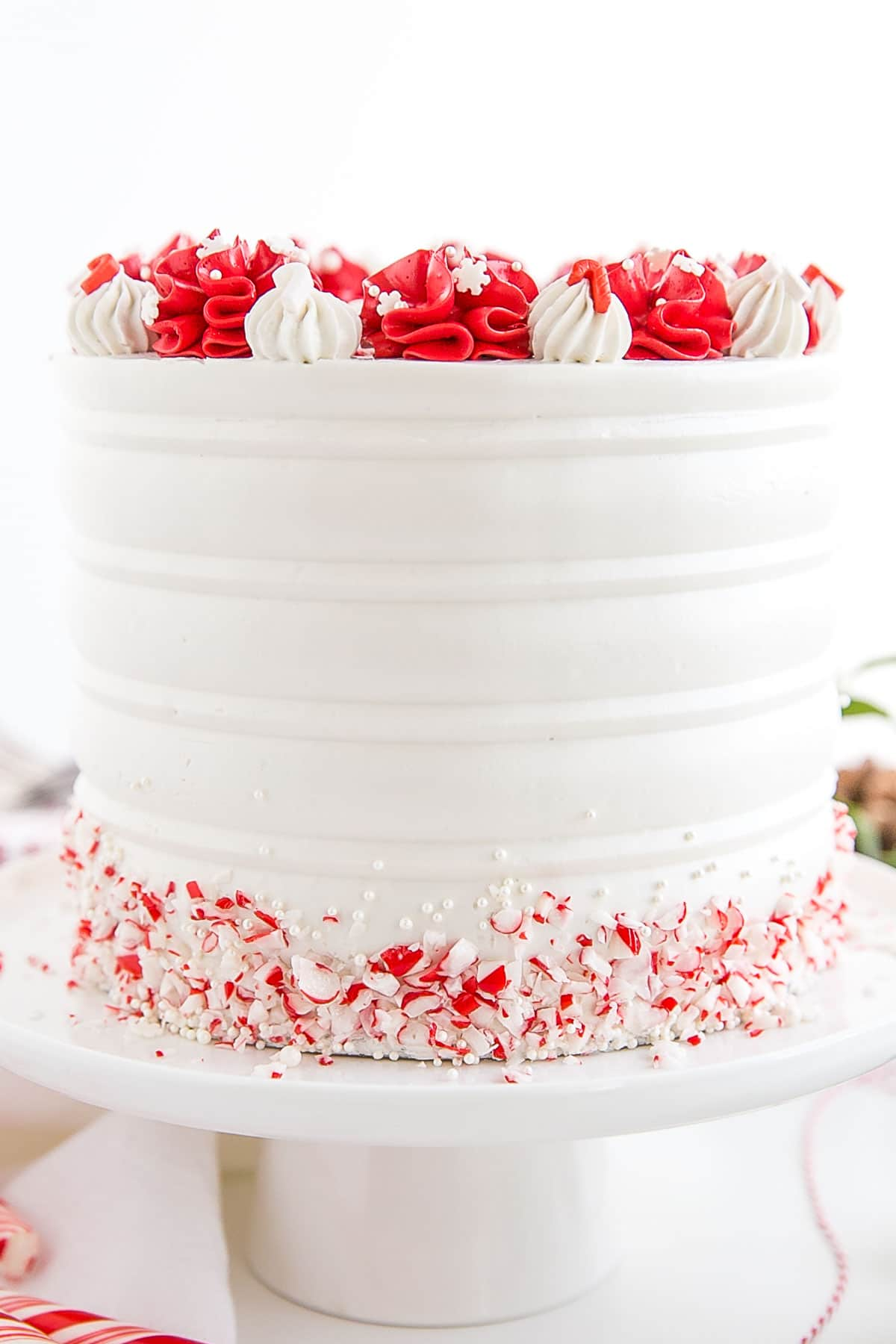 Close up of the sides of the cake and the white buttercream.